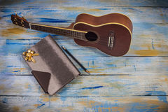 Ukulele with notebook and pencil Royalty Free Stock Images