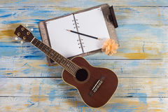 Ukulele with notebook and pencil Royalty Free Stock Photo