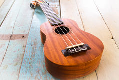 Ukulele on the old wood table. Music Stock Photos
