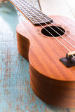 Ukulele on the old wood table. Music Stock Images
