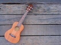 ukulele on old wooden Royalty Free Stock Photos