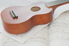 Ukulele and Sheet Music Royalty Free Stock Images