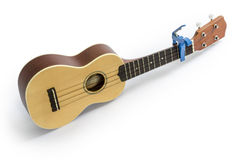 Ukulele  and Tuner isolated on white Clipping path included Stock Photos