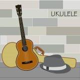 Ukulele und Panama-Hut Lizenzfreies Stockbild