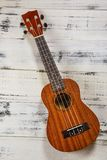 Ukulele in vintage wood background. Little four-string Hawaiian Guitar, on a dark wooden background Stock Photography
