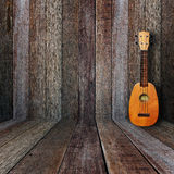 Ukulele. In vintage wood room Royalty Free Stock Photography