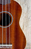 Ukulele on wood background Stock Images