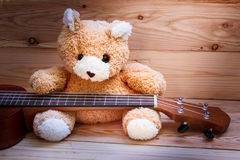 Ukulele on wood background. Royalty Free Stock Images