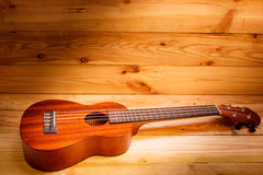 Ukulele on wood background. Stock Photo