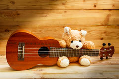 Ukulele on wood background. Stock Images