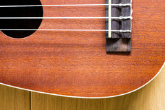 Ukulele on wood background Royalty Free Stock Photo