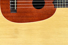 Ukulele on wood background Royalty Free Stock Image