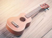 Ukulele on wood background Stock Image