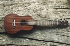 Ukulele on wood Royalty Free Stock Images
