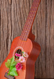 Ukulele on wooden backgrounds. Music Stock Photography