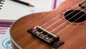 Ukulele. And written heart  with pencil on notebook Royalty Free Stock Images