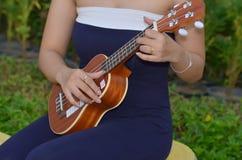 Ukulele. Young woman plays ukulele thailand Royalty Free Stock Photo