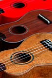 Ukuleles. Three ukuleles lined up side by side Royalty Free Stock Photos