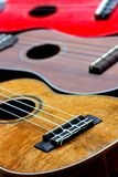 Ukuleles. Three ukuleles lined up side by side Stock Photos