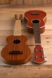 Ukuleles on the wooden terrace. Ukuleles on the  light brown wooden terrace Stock Photo
