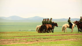ULAANBAATAR, MONGOLIA - JULY 2013: Mongolian Cavalry at Naadam Festival stock video