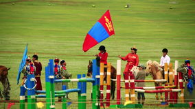 ULAANBAATAR, MONGOLIA - JULY 2013: Mongolian Cavalry at Naadam Festival. At background, polo games playing stock footage
