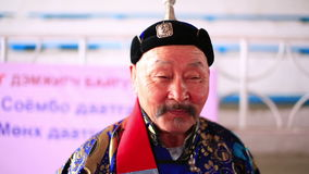 ULAANBAATAR, MONGOLIA - JULY 2013: Mongolian man with traditional clothes stock video footage
