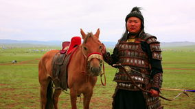 ULAANBAATAR, MONGOLIA - JULY 2013: Naadam Festival Horse Archery Crew. With horse and traditional medieval outfit, posing stock footage