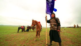 ULAANBAATAR, MONGOLIA - JULY 2013: Naadam Festival Horse Archery Crew. With horse and traditional medieval outfit, posing stock video footage