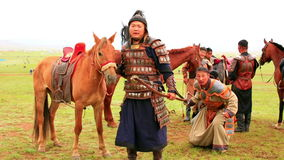 ULAANBAATAR, MONGOLIA - JULY 2013: Naadam Festival Horse Archery Crew. With horse and traditional medieval outfit, posing stock video