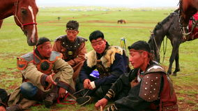 ULAANBAATAR, MONGOLIA - JULY 2013: Naadam Festival Horse Archery Crew. With traditional medieval outfit before the show drinking kumis stock video footage