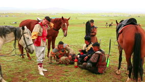 ULAANBAATAR, MONGOLIA - JULY 2013: Naadam Festival Horse Archery Crew. With traditional medieval outfit before the show drinking kumis stock footage