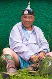Naadam Festival Heavyweight Wrestler Sitting Grass. Ulaanbaatar, Mongolia - June 11, 2007: Heavyweight wrestler smiling and sitting on grass rests before his Stock Images