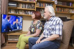 Inauguration of the Russian president. ULAN - UDE, RUSSIA - June, 09.2018: Russian pensioners watch TV on NTV channel `The direct line of Russian President royalty free stock images