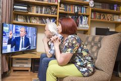 Inauguration of the Russian president. ULAN - UDE, RUSSIA - June, 09.2018: Russian pensioners watch TV on NTV channel `The direct line of Russian President stock images