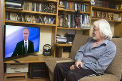 Inauguration of the Russian president. ULAN - UDE, RUSSIA - MAY 07, 2018: Russian pensioners look at the inauguration of Russian President Vladimir Putin on TV stock photo