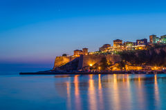 Ulcinj old town fortress at night with silky water and stars on a sky. Royalty Free Stock Photography