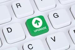 Ulepsza ulepszać oprogramowanie programa ikony symbol na komputerowym keybo Zdjęcie Royalty Free