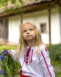 Little ukrainian girl watching magpie. Little girl Uliya holding her couronne from flowers royalty free stock photos