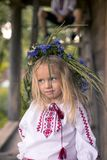 little ukrainian girl in circlet of blue flowers Stock Photo