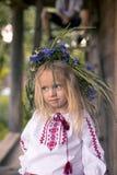 Little ukrainian girl in circlet of blue flowers. Little Ukrainian girl in the coronet from flowers stock photo