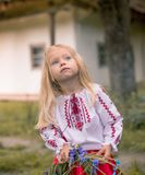 Little ukrainian girl watching magpie  Stock Images