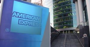 Uliczna signage deska z American Express logem Nowożytny biura centrum drapacz chmur i schodka tło Artykuł wstępny 3D Fotografia Royalty Free