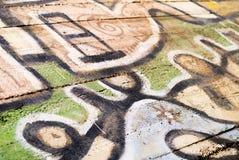 Uliczna sztuka - stary graffiti na ścianie Zdjęcie Royalty Free