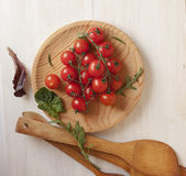 Ull top view of a bunch of cherry tomatoes on a wooden board. For the background Royalty Free Stock Photos
