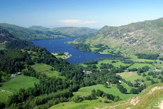 Ullswater in the English Lake District. The English Lake District in Summer, with beautiful blue sky and lush greenery surrounding Ullswater royalty free stock photo