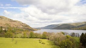 Ullswater and the English lake district. A side tracking aerial drone view of the hills and countryside around Ullswater in the heart of the English lake stock video