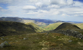 The Ullswater Fells. Dry stone wall down to Hartsop Stock Photography
