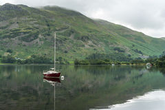 Free ULLSWATER, LAKE DISTRICT/ENGLAND - AUGUST 22 : Red Yacht Moored Stock Photo - 72521660