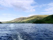 On Ullswater looking to Bonscale Pike to the right Royalty Free Stock Photos